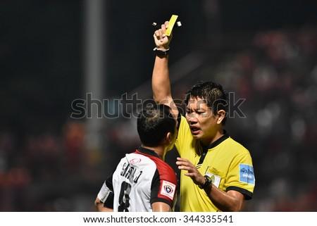 BANGKOK THAILAND-NOV22:Unidentified referee show yellow card during Thai Premier League2015 between Thai Port Fc and Osotspa FCat PAT Stadium on November22,2015 in Bangkok Thailand - stock photo