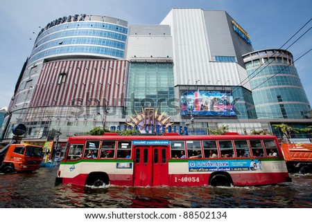 BANGKOK, THAILAND - NOVEMBER 9: A city bus makes its way through a major flooded street in the Phahonyothin road on November 9, 2011 Bangkok, Thailand. - stock photo
