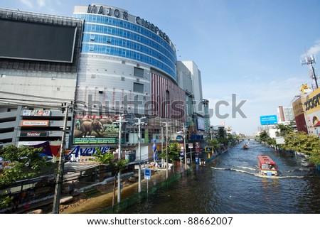 BANGKOK, THAILAND - NOVEMBER 7: A city bus makes its way through a major flooded street in the Phahonyothin road on November 7, 2011 Bangkok, Thailand. - stock photo