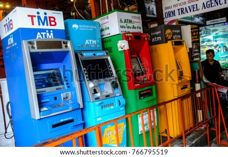 BANGKOK, THAILAND - NOVEMBER 18, 2017 : A few ATM machines near at popular backpacker destination Khao San Road. The area is famous for its street market in Thailand.