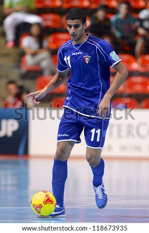 BANGKOK,THAILAND-NOVEMBER 06: Abdullah Dabi of Kuwait runs with the ball during the FIFA Futsal World Cup between Kuwait and Serbia at Indoor Stadium Huamark on Nov6, 2012 in Bangkok,Thailand.