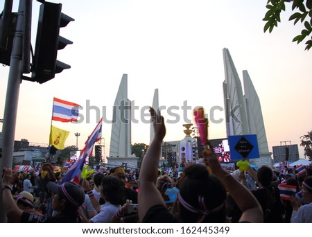 BANGKOK, THAILAND- NOVEMBER 11 : Against amnesty bill protesters weave Thai flag  and blow whistle at Democracy monument, on November 11, 2013 in Bangkok THAILAND - stock photo
