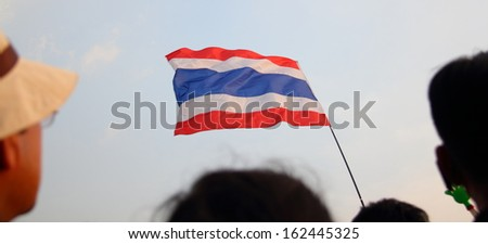 BANGKOK, THAILAND- NOVEMBER 11 : Against amnesty bill protesters weave Thai flag  at Democracy monument, on November 11, 2013 in Bangkok THAILAND - stock photo