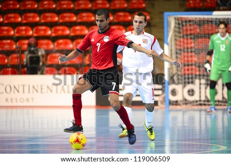 BANGKOK,THAILAND-NOVEMBER 06:Ahmed About Serie of Egypt (red) in action during  the FIFA Futsal World Cup between Egypt and Czech Republic at Indoor Stadium Huamark on Nov6,2012 in,Thailand. - stock photo