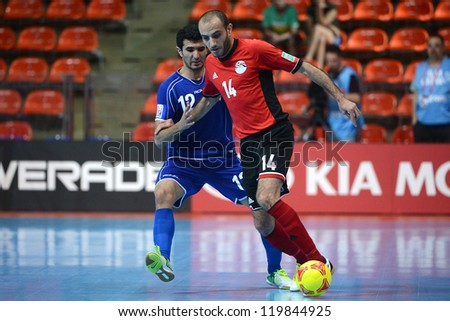 BANGKOK,THAILAND-NOVEMBER 09:Ahmed Mohamed  (red) of Egypt control the ball during the FIFA Futsal World Cup between Kuwait and Egypt at Indoor Stadium Huamark on Nov9,2012 in Bangkok,Thailand. - stock photo
