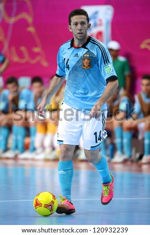 BANGKOK, THAILAND - NOVEMBER 11: Alemao of Spain (blue) for the ball during the FIFA Futsal World Cup  between Thailand and Spain at Nimibutr Stadium on Nov11, 2012 in Bangkok,Thailand.