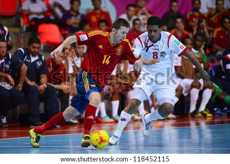 BANGKOK, THAILAND-NOVEMBER 05:Alemao (red)of Spain runs with the ball during the FIFA Futsal World Cup between Spain and Panama at Indoor Stadium Huamark on November 5, 2012 in Bangkok,Thailand.