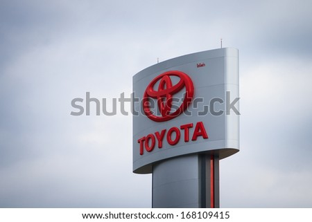 BANGKOK, THAILAND - NOVEMBER 26 : An emblem of Toyota dealer, shot in front  of Toyota dealer Thailand, November 26 2013, Bangkok, Thailand. Toyota Motor Corporation is headquartered in Toyota, Japan