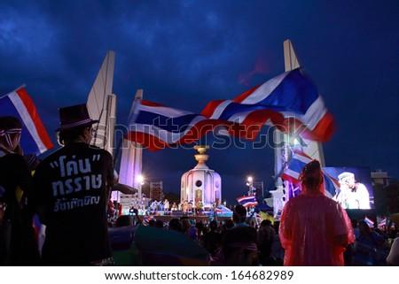 BANGKOK, THAILAND - NOVEMBER 26 : Anti-government protesters wave  national flags during a rally at Democracy Monument on November 26, 2013  in Bangkok, Thailand. - stock photo