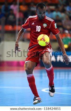 BANGKOK,THAILAND-NOVEMBER 05:Aziz Derrou of Morocco runs with the ball during the FIFA Futsal World Cup between Morocco and Iran at Indoor Stadium Huamark on Nov5, 2012 in Bangkok,Thailand. - stock photo