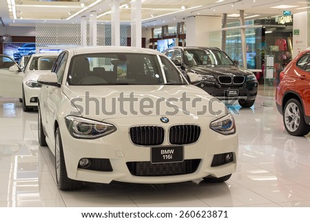 BANGKOK,THAILAND - NOVEMBER 19, 2013 : BMW 116i car on display at the Siam Paragon Mall in Bangkok. With 300,000 sq m of retail space Siam Paragon is one of the world's largest malls. - stock photo