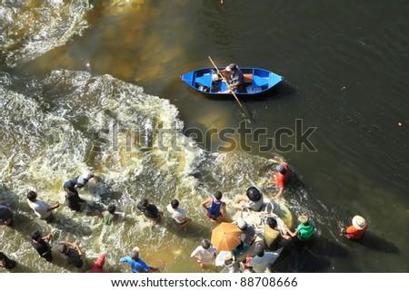 BANGKOK, THAILAND - NOVEMBER 13: Boat passing through flush water during the worst monsoon flooding in decades in Bangkok, Thailand on November 13, 2011. - stock photo