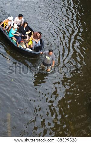 BANGKOK, THAILAND-NOVEMBER 8: Cars and trucks navigate through the flood after the heaviest monsoon rain in 20 years in the capital on  November 8, 2011   Ngam Wong Wan Road, Bangkok, Thailand. - stock photo