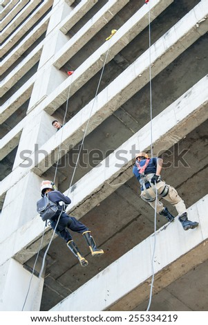 BANGKOK THAILAND-NOVEMBER 01: Firefighters practice rappelling on tower. on November 01, 2009 in Talingchan, Bangkok, Thailand.