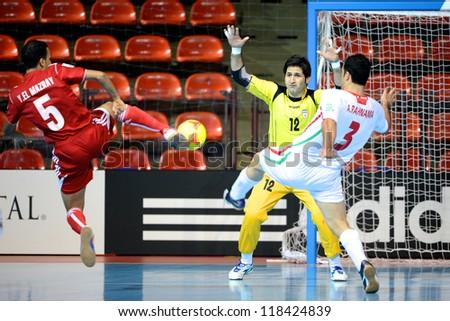 BANGKOK,THAILAND-NOVEMBER 05:Goalkeeper Mostafa Nazari (no.12) of Iran in action during the FIFA Futsal World Cup between Morocco and Iran at Indoor Stadium Huamark on Nov5, 2012 in Bangkok,Thailand. - stock photo