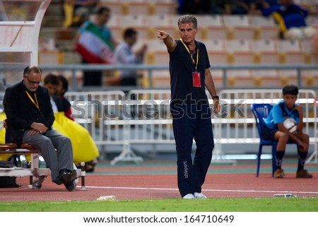 BANGKOK THAILAND-NOVEMBER 15:Head coach Carlos Queiroz of Iran in action during the 2015 AFC Asian Cup qualifiers between Thailand and Iran at Rajamangala stadium on Nov15, 2013 in Thailand. - stock photo