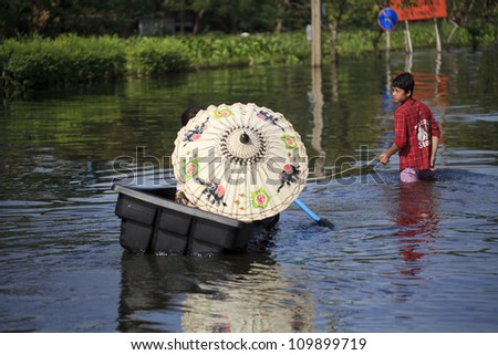 BANGKOK, THAILAND - NOVEMBER 6: Huge flood disaster in Thailand. As a result, unidentified people have to be evacuated from their houses - November 6, 2011 in Nonthaburi, Thailand - stock photo