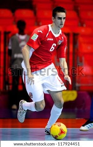 BANGKOK,THAILAND-NOVEMBER 3:Jiri Novotny of Czech Republic for the ball during the FIFA Futsal World Cup between Czech Republic and Kuwait at Indoor Stadium Huamark on Nov3, 2012 in Thailand. - stock photo