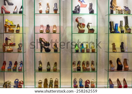 BANGKOK, THAILAND - NOVEMBER 19, 2013 : Lot women shoes brand name - Jeffrey Campbell Shoes on a glass shelf at the Siam Paragon Mall. Siam Paragon is a one of the biggest shopping centres in Asia.