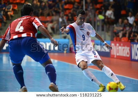 BANGKOK,THAILAND-NOVEMBER 4:Marco Carvajal(white)of Costa Rica in action during the FIFA Futsal World Cup between Paraguay and Costa Rica at Indoor Stadium Huamark on Nov4, 2012 in Bangkok, Thailand.