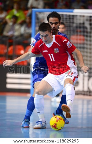 BANGKOK,THAILAND-NOVEMBER 3:Michal Belej of Czech Republic for the ball during the FIFA Futsal World Cup between Czech Republic and Kuwait at Indoor Stadium Huamark on Nov3, 2012 in Thailand. - stock photo