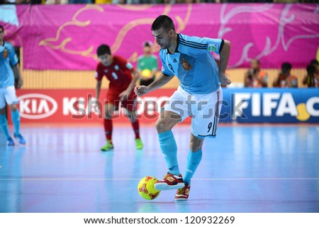 BANGKOK, THAILAND - NOVEMBER 11: Miguelin of Spain (blue) for the ball during the FIFA Futsal World Cup  between Thailand and Spain at Nimibutr Stadium on Nov11, 2012 in Bangkok,Thailand.