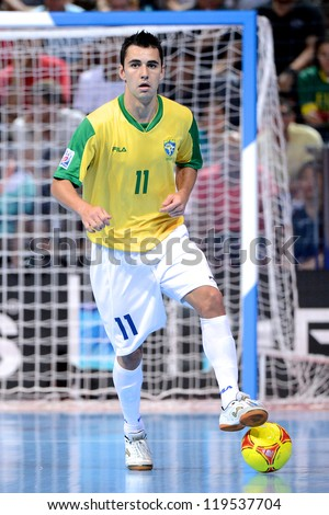 BANGKOK,THAILAND-NOVEMBER18:Neto of Brazil control the ball during the FIFA Futsal World Cup Final between Spain and Brazil at Indoor Stadium Huamark on Nov18, 2012 in,Thailand.