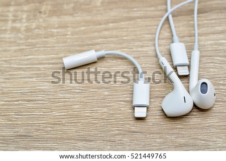 Bangkok, Thailand - November 23, 2016 : New Apple iPhone 7 - Lightning to 3.5 mm Headphone Jack Adapter and Earpods. New Apple iPhone acclaims to become the most popular smart phone.