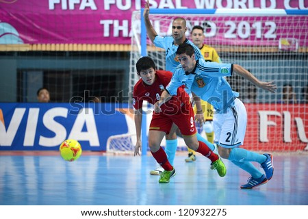 BANGKOK, THAILAND - NOVEMBER 11:Ortiz of Spain (blue) in action during the FIFA Futsal World Cup  between Thailand and Spain at Nimibutr Stadium on Nov11, 2012 in Bangkok,Thailand.