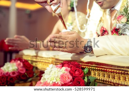 Bangkok, Thailand - November 12, 2016 - People pour blessing water for bride and groom to be happiness