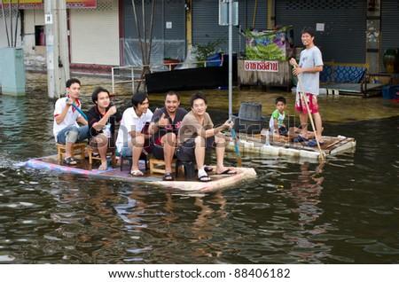 BANGKOK, THAILAND-NOVEMBER 8: People use boats and rafts as transportation through water during the worst flooding in decades on November 8, 2011 Ngam Wong Wan Road, Bangkok, Thailand. - stock photo