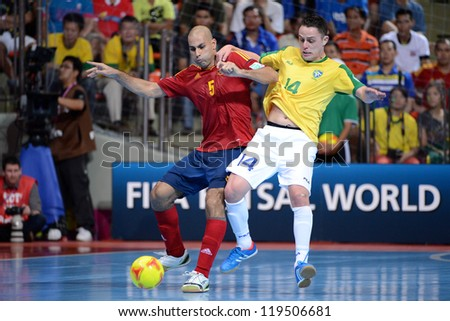 BANGKOK,THAILAND-NOVEMBER18:Rodrigo (yellow) of Brazil in action during the FIFA Futsal World Cup Final between Spain and Brazil at Indoor Stadium Huamark on Nov18, 2012 in,Thailand.