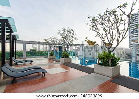 BANGKOK, THAILAND - NOVEMBER 13, 2015: Roof top luxury swimming pool. In Bangkok there is a high concentration of swimming pools due to climate conditions.