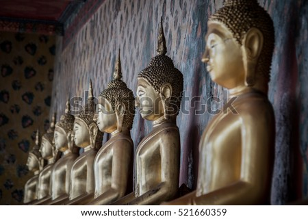 Bangkok, THAILAND - November 21, 2016 Selective focus point on row Buddha statue in long corridor at Wat Arun temple which is a public place, Bangkok Thailand. Photo taken on: 21 November , 2016