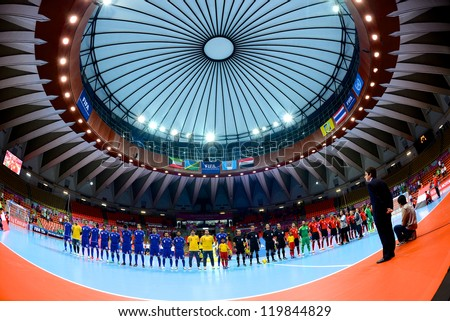 BANGKOK,THAILAND-NOVEMBER 09:Teams line up for the national anthem during  the FIFA Futsal World Cup between Kuwait and Egypt at Indoor Stadium Huamark on Nov9, 2012 in Bangkok, Thailand. - stock photo