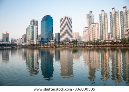 BANGKOK, THAILAND-NOVEMBER 2 : The business skyscraper skyline are in Bangkok city downtown with reflection on wide lake in evening at November 2,2015 in Bangkok, Thailand.