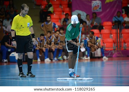 BANGKOK,THAILAND-NOVEMBER3:The staff was mopping the floor during the FIFA Futsal World Cup between Czech Republic and Kuwait at Indoor Stadium Huamark on Nov3, 2012 in Thailand. - stock photo