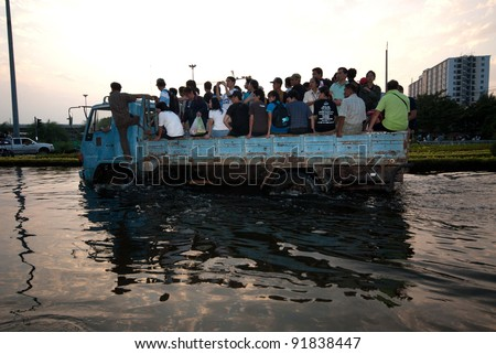 BANGKOK, THAILAND-NOVEMBER 11: Transportation of people in the streets flooded after the heaviest monsoon rain in 50 years in the capital on November 11, 2011 Phahon Yothin Road, bangkok, Thailand. - stock photo