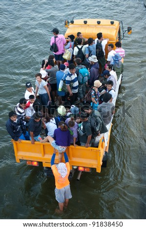 BANGKOK, THAILAND-NOVEMBER 20: Transportation of people in the streets flooded after the heaviest monsoon rain in 50 years in the capital on November 20, 2011 Phahon Yothin Road, bangkok, Thailand. - stock photo
