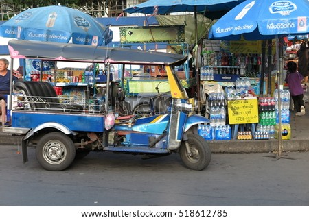 BANGKOK, THAILAND - NOVEMBER 16, 2016 : Tuk Tuk taxi at traditional street food market in Bangkok, Thailand