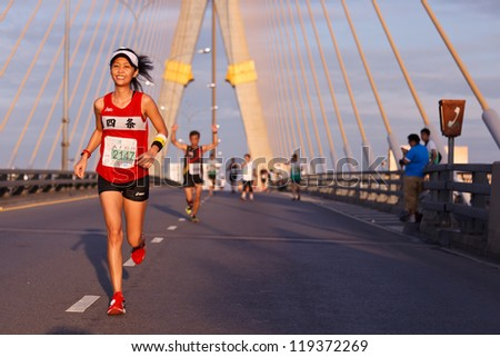 BANGKOK, THAILAND - NOVEMBER 18 : Unidentified marathon runners  at  Standard Charterd Bangkok Marathon 2012 running championship on November 18, 2012 in Bangkok, Thailand. - stock photo