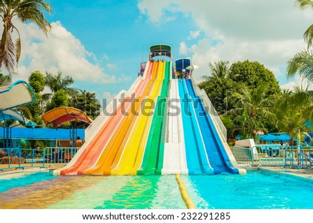 BANGKOK, THAILAND - NOVEMBER 9: Unidentified people play slide at Siam Park City water park in Bangkok, Thailand on November 9, 2014 - stock photo