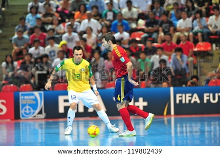 BANGKOK, THAILAND - NOVEMBER 18:Unidentified players in FIFA Futsal World Cup between Brazil and Spain at Indoor Stadium Huamark on November 18, 2012 in Bangkok, Thailand. - stock photo