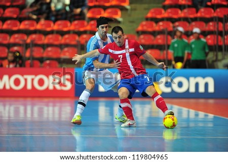 BANGKOK, THAILAND - NOVEMBER 12: Unidentified players in FIFA Futsal World Cup Round of 16 match between Serbia and Argentina at Indoor Stadium Huamark on November 12, 2012 in Bangkok, Thailand. - stock photo