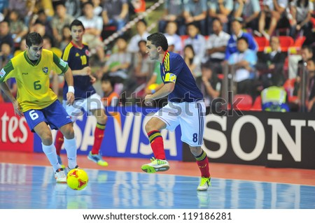 BANGKOK, THAILAND - NOVEMBER 16: Unidentified players in FIFA Futsal World Cup, Semi-Final match between Brazil and Colombia at Indoor Stadium Huamark on November 16, 2012 in Bangkok, Thailand. - stock photo