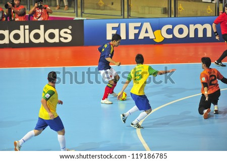 BANGKOK, THAILAND - NOVEMBER 16 : Unidentified players in FIFA Futsal World Cup, Semi-Final match between Brazil and Colombia at Indoor Stadium Huamark on November 16, 2012 in Bangkok, Thailand.