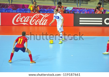BANGKOK, THAILAND - NOVEMBER 16: Unidentified players in FIFA Futsal World Cup Semi-Final match between Italy and Spain at Indoor Stadium Huamark on November 16, 2012 in Bangkok, Thailand. - stock photo