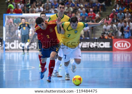 BANGKOK,THAILAND-NOVEMBER 18: Vinicius (yellow) of Brazil in action during the FIFA Futsal World Cup Final  between Spain and Brazil at Indoor Stadium Huamark on Nov18, 2012 in Bangkok, Thailand.