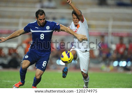 BANGKOK THAILAND-NOVENBER 27:Dennis Mengoy Cagara (blue) of Philippines in action during  the AFF Suzuki Cup between Vietnam and Philippines at Rajamangala stadium on Nov27, 2012 in,Thailand.
