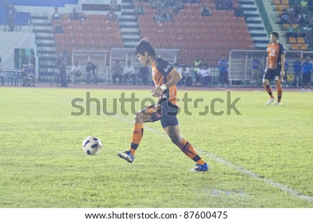 BANGKOK, THAILAND- OCT 26 : A.Kitpongsri (O) in action during Thaicom FA Cup between Army Utd. (G) vs Chonburi fc (O) on October 26, 2011 at Army Stadium in Bangkok, Thailand